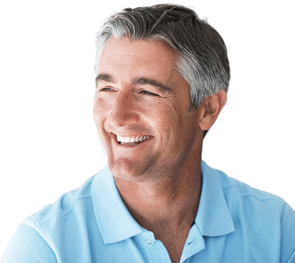 Smiling senior man in front of dental office