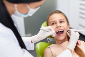 A young girl at her dental exam.